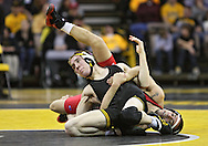 January 22 2010: Iowa's Matt McDonough and Ohio State's Bo Touris battle for control during the 125-pound bout an NCAA wrestling dual at Carver-Hawkeye Arena in Iowa City, Iowa on January 22, 2010. McDonough pinned Touris in 4:37 and Iowa defeated Ohio State 33-3..