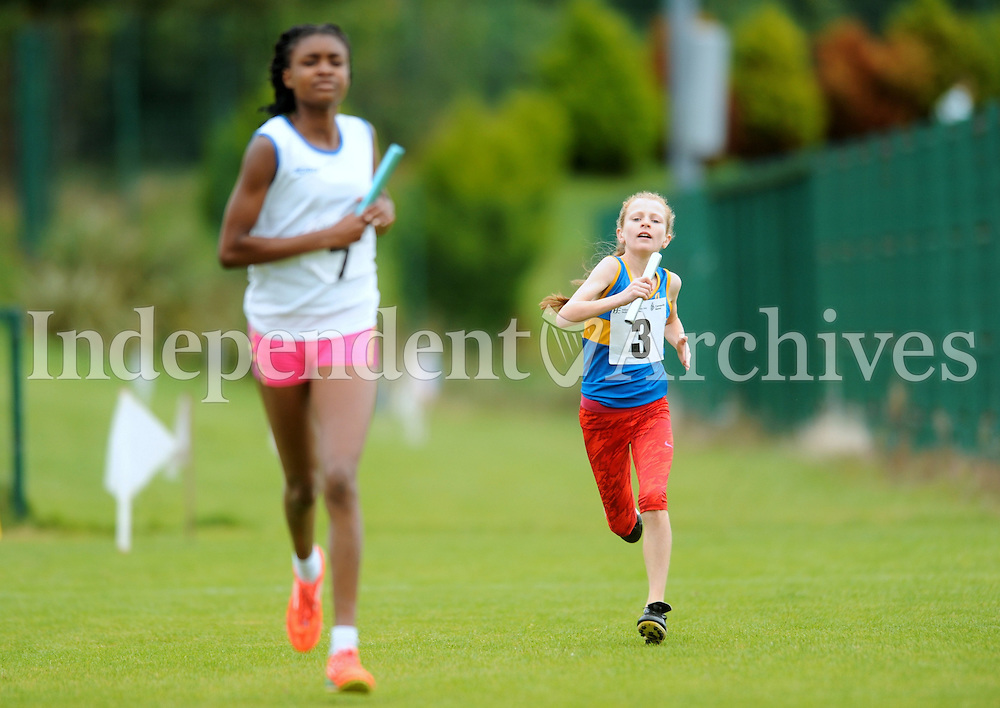13 Aug 2016:  Ellen Cunneen, 13, from Templederry, Tipperary, tries to catch Helen Ikeotokin, 12, from Portarlington, Laois, in the U14 Mixed Distance Relay.  2016 Community Games National Festival 2016.  Athlone Institute of Technology, Athlone, Co. Westmeath. Picture: Caroline Quinn