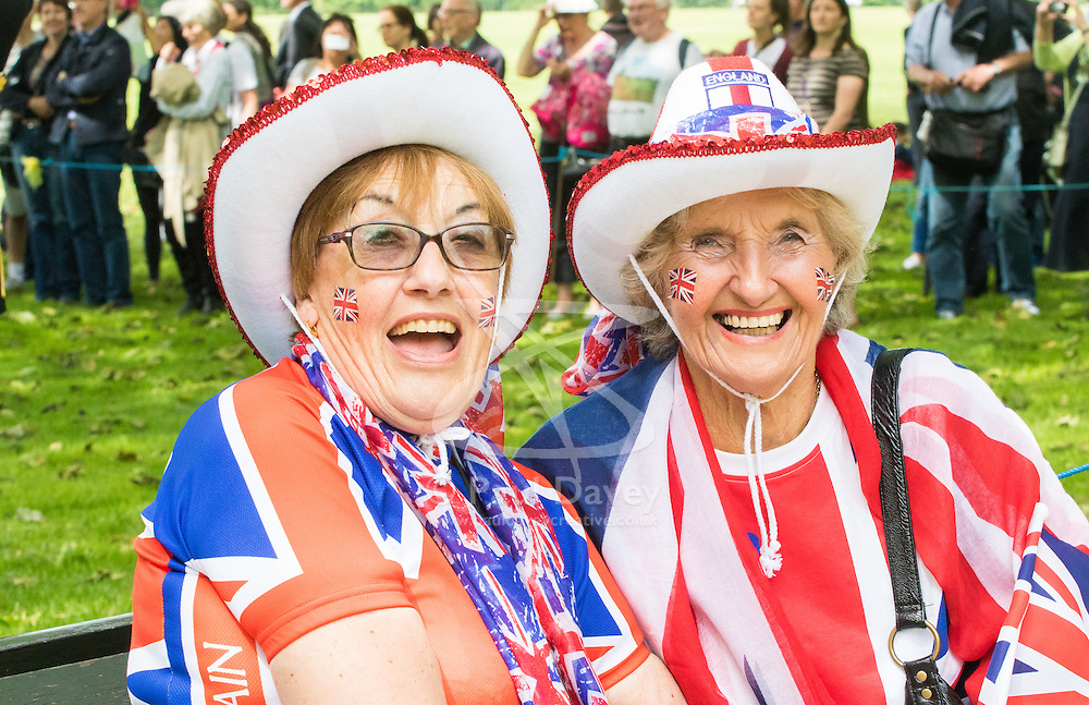 Hyde Park, London, June 10th 2016. As  part of the double celebration of HM The Queen and her Husband HRH Prince Philip, the King's Troop Royal Horse Artillery fire a 41 gun salute in honour of Prince Philip's 95th birthday in London's Hyde Park. PICTURED: Two patriotic ladies wait for the salute.