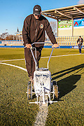 Groundsman lining the pitch during the The FA Cup match between Curzon Ashton and AFC Wimbledon at Tameside Stadium, Ashton Under Lyne, United Kingdom on 4 December 2016. Photo by Simon Davies.
