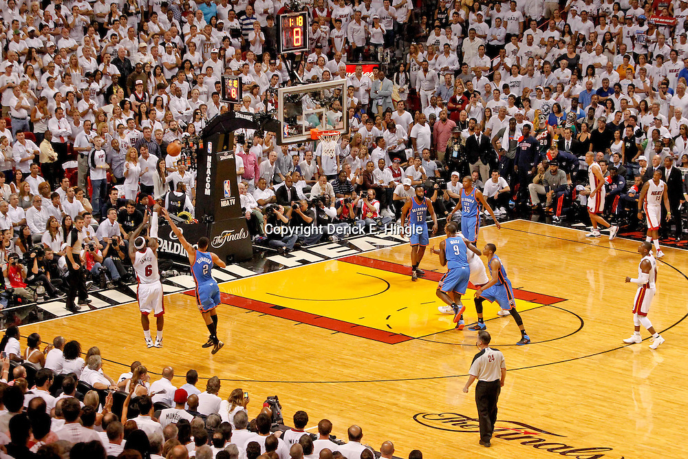 Jun 19, 2012; Miami, FL, USA; Miami Heat small forward LeBron James (6) shoots a three pointer over Oklahoma City Thunder shooting guard Thabo Sefolosha (2) during the fourth quarter in game four in the 2012 NBA Finals at the American Airlines Arena. Miami won 104-98. Mandatory Credit: Derick E. Hingle-US PRESSWIRE