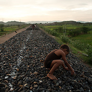 A young boy plays at the construction site of future train tracks to Pushkar, which cut through the village of Kankarda, on the outskirts of Ajmer, Rajasthan.  Residents were forced to sell their land to the government for the construction of the railway in 2007.