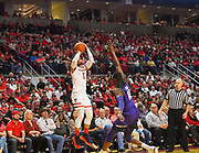 LUBBOCK, TX - MARCH 3: Brandone Francis #1 of the Texas Tech Red Raiders shoots the ball over Kouat Noi #12 of the TCU Horned Frogs during the game on March 3, 2018 at United Supermarket Arena in Lubbock, Texas. Texas Tech defeated TCU 79-75. Texas Tech defeated TCU 79-75. (Photo by John Weast/Getty Images) *** Local Caption *** Brandone Francis;Kouat Noi
