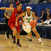 Skylar Diggins, Notre Dame, in action against Bria Smith, (left) during the Notre Dame Fighting Irish V Louisville Cardinals Semi Final match during the Big East Conference, 2013 Women's Basketball Championships at the XL Center, Hartford, Connecticut, USA. 11th March. Photo Tim Clayton