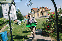 COMO, ITALY - 21 JUNE 2017: Giusto Della Valle, a local priest who since 2011 has run a center on the outskirts of town where more than 50 migrants sleep at night, carries a basket of home-grown beans in the center, in Como, Italy, on June 21st 2017.<br /> <br /> Residents of Como are worried that funds redirected to migrants deprived the town's handicapped of services and complained that any protest prompted accusations of racism.<br /> <br /> Throughout Italy, run-off mayoral elections on Sunday will be considered bellwethers for upcoming national elections and immigration has again emerged as a burning issue.<br /> <br /> Italy has registered more than 70,000 migrants this year, 27 percent more than it did by this time in 2016, when a record 181,000 migrants arrived. Waves of migrants continue to make the perilous, and often fatal, crossing to southern Italy from Africa, South Asia and the Middle East, seeing Italy as the gateway to Europe.<br /> <br /> While migrants spoke of their appreciation of Italy's humanitarian efforts to save them from the Mediterranean Sea, they also expressed exhaustion with the country's intricate web of permits and papers and European rules that required them to stay in the country that first documented them.