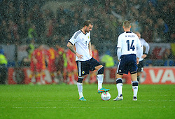 Scotland's Steven Fletcher (Sunderland)  cuts a dejected figure on his return to the national team as Wales celebrate in the back ground - Photo mandatory by-line: Joe Meredith/JMP  - Tel: Mobile:07966 386802 12/10/2012 - Wales v Scotland - SPORT - FOOTBALL - World Cup Qualifier -  Cardiff   - Cardiff City Stadium -