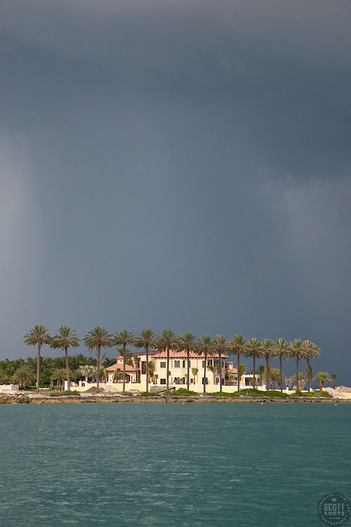 Beautiful house in the Bahamas with cloudy sky.