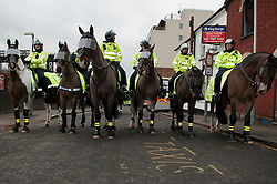 """© under license to London News Pictures.  05/02/2011. Police Line up on horseback in Luton at an English Defence League protest titled """"Back To Where It All Began."""" Photo credit should read Michael Graae/London News Pictures"""