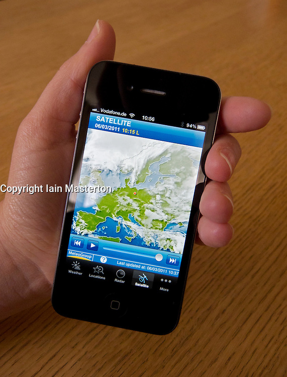Checking weather forecast using satellite image on Apple iphone 4G smartphone