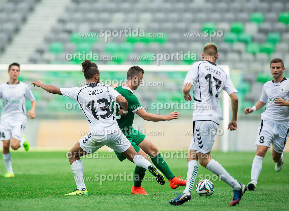 Lamin Diallo of Krka vs Andraz Sporar #10 of Olimpija during football match between NK Olimpija and NK Krka in Round 1 of Prva liga Telekom Slovenije 2014/15, on July 19, 2014 in SRC Stozice, Ljubljana, Slovenia. Photo by Vid Ponikvar / Sportida.com