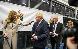 © Licensed to London News Pictures. 13/12/2019. London, UK. British Prime Minister BORIS JOHNSON is greeted by his partner CARRIE SYMONDS after being elected as speaks after being elected as MP for Uxbridge and South Ruislip. A general election was called for December 12th following a deadlock in Parliament over the UK's decision to leave the EU. Photo credit: Ben Cawthra/LNP