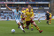 Huddersfield Town forward Nahki Wells (21)  and Burnley defender Ben Mee (6) battle it out during the Sky Bet Championship match between Huddersfield Town and Burnley at the John Smiths Stadium, Huddersfield, England on 12 March 2016. Photo by Simon Davies.
