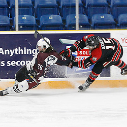 "TRENTON, ON  - MAY 2,  2017: Canadian Junior Hockey League, Central Canadian Jr. ""A"" Championship. The Dudley Hewitt Cup. Game 1 between Dryden GM Ice Dogs and the Georgetown Raiders.  Garett Graham #26 of the Dryden GM Ice Dogs  battle for the puck with Scott Docherty #15 of the Georgetown Raiders during the second period.  <br /> (Photo by Tim Bates / OJHL Images)"