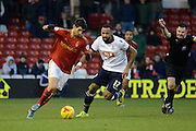 Nottingham Forest striker Nelson Castro Oliveira turns Bolton Wanderers midfielder Liam Trotter during the Sky Bet Championship match between Nottingham Forest and Bolton Wanderers at the City Ground, Nottingham, England on 16 January 2016. Photo by Alan Franklin.
