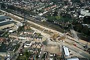 Nederland, Gelderland, Zevenaar, 04-04-2002; de dorpkern van Zevenaar wordt doorsneden door de spoorlijn Arnhem - Emmerich (Duitsland), parallel hieraan komt ook de Betuweroute te lopen; deze goederenspoorlijn krijgt een tunnel om geluidsoverlast te voorkomen; tussen de damwanden wordt de tunnel uitgegraven; verkeer en vervoer milieu.Deel van een serie over Betuweroute / infrastructuur.<br /> luchtfoto (toeslag), aerial photo (additional fee)<br /> photo/foto Siebe Swart