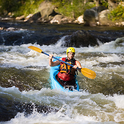 Whitewater kayaking Zoar Rapid on the Deerfield River in Charlemont, Massachusetts.