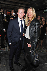 CHELSY DAVY and GUY PELLY at the launch party for the new nightclub Tonteria, 7-12 Sloane Square, London on 25th October 2012.