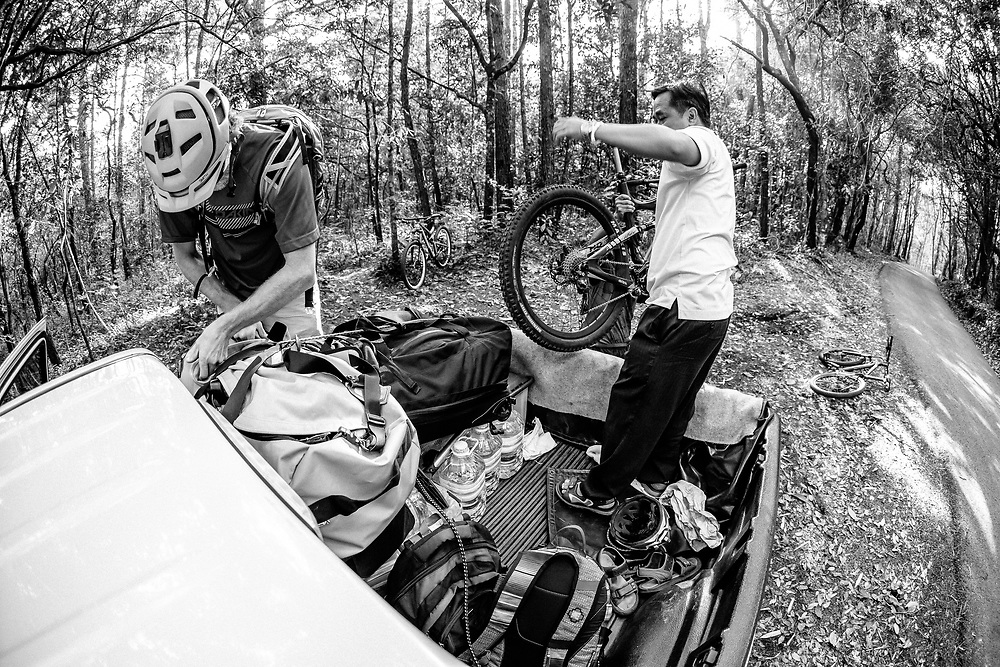 Mr. Sak, Andrew Whiteford, and Win Jalawin unload bikes at the top of Doi Suthep near Chiang Mai, Thailand.