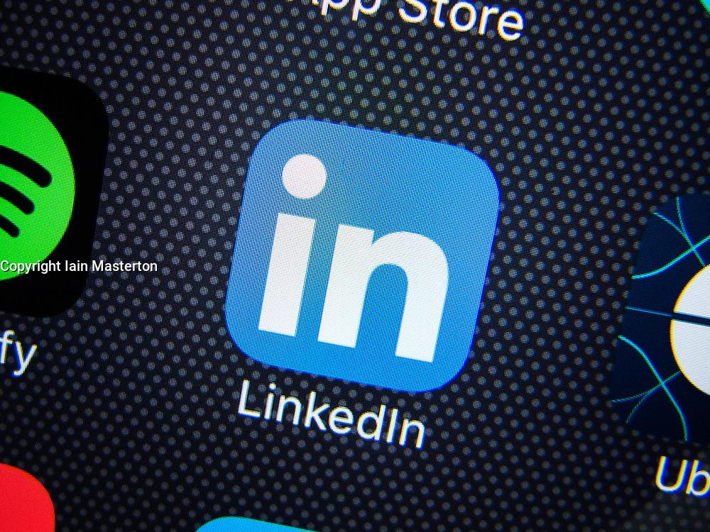 LinkedIn professional social networking app logo on screen of iPhone 6 Plus smart phone