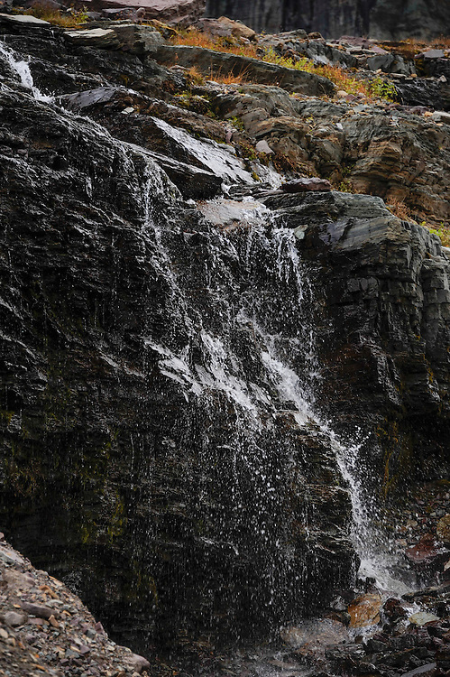A small waterfall in the rock at the base of Mount Clements at Logan Pass, Glacier National Park, Montana, Tuesday, October 7, 2014. According to Dan Fagre Ph.D. of the USGS receding glaciers in the park means that streams dry up in late summer and fall.