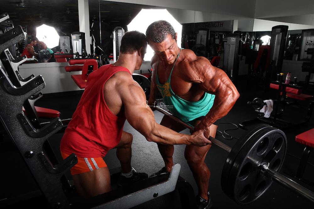 Bodybuilders Dan Decker and Brian Yersky doing bent over back rows.