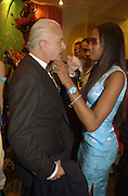 Manolo Blahnik and Naomi Campbell. Shanghai Tang opening. Sloane St. 11 April 2001. © Copyright Photograph by Dafydd Jones 66 Stockwell Park Rd. London SW9 0DA Tel 020 7733 0108 www.dafjones.com