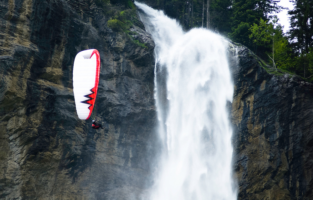 A paraglider flys past Staubbach Falls in Lauterbrunnen Valley, Switzerland.