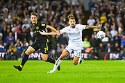 Leeds United midfielder Kalvin Phillips (23) and Brentford forward Sergi Canos (7) during the EFL Sky Bet Championship match between Leeds United and Brentford at Elland Road, Leeds, England on 21 August 2019.