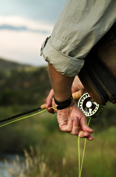 Fly fisherman in Montana stripping fly line.