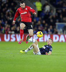 Cardiff City Midfielder, Jordon Mutch (ENG) evades the challenge of Man Utd Midfielder Tom Cleverley (ENG) - Photo mandatory by-line: Joseph Meredith/JMP - Tel: Mobile: 07966 386802 - 24/11/2013 - SPORT - FOOTBALL - Cardiff City Stadium - Cardiff City v Manchester United - Barclays Premier League.