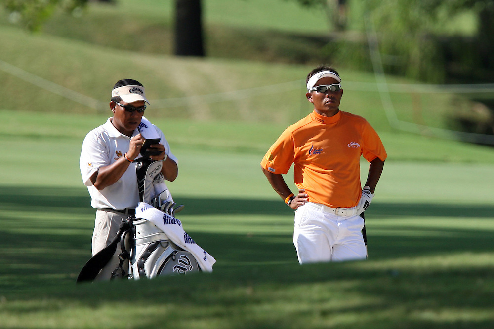 09 August 2007: Thongchi Jaidee and caddie Surawat Wannapintu survey the next shot on the 9th fairway during the first round of the 89th PGA Championship at Southern Hills Country Club in Tulsa, OK.