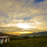 View of hills, house and clouds in southern Ecuador