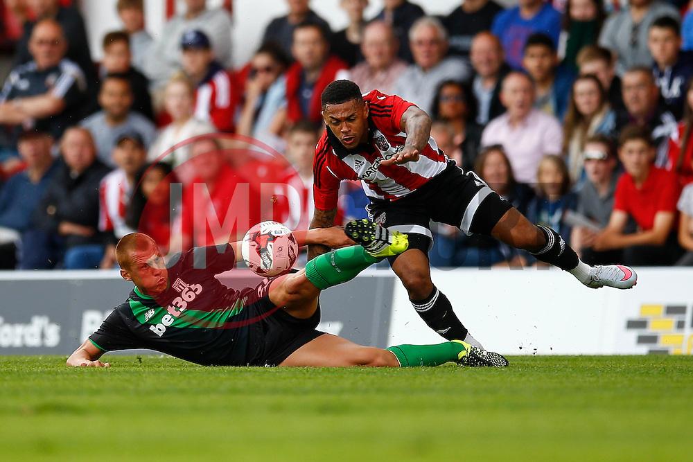 Steve Sidwell of Stoke City sliding tackle on Andre Gray of Brentford - Mandatory by-line: Jason Brown/JMP - Mobile 07966 386802 25/07/2015 - SPORT - FOOTBALL - Brentford, Griffin Park - Brentford v Stoke City - Pre-Season Friendly