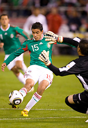 February 24, 2010; San Francisco, CA, USA;  Mexico forward Pablo Berrera (15) shoots on Bolivia goalkeeper Daniel Vaca (1) during the first half at Candlestick Park. Mexico defeated Bolivia 5-0.