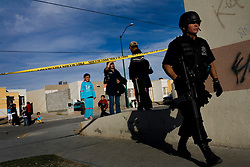 Police in Ciudad Juarez, Mexico secure the scene of a murder.  Mexico is undergoing a violent war with the nation's drug cartels and Ciudad Juarez has become the murder capital of Mexico, with over 4,000 murders in the past two years.  President Felipe Calderon has dispatched thousands of soldiers and federal police officers in order to contain the situation, but they have not been successful.