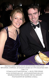 Olympic Gold medal winner DR STEPHANIE COOK and MR DANIEL CARROLE, at a ball in London on 17th December 2001.		OWJ 113