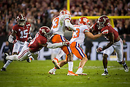 #10 Reuben Foster of Alabama, tackles #3 Artavis Scott of Clemson.