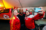 Kansas City Corporate Event and Marketing Photographer - Former NFL player, Dante Hall, poses for selfies with fans at the Built Ford Tough Toughest Tailgate at Arrowhead Stadium on Sunday, December 25, 2016, in Kansas City, MO. Colin E. Braley for Ford