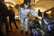A anti-terrorism police and his sniffer dog checks immigrants for explosives at the Komsomolskaya metro station on the ring line. .The Moscow Metro, which spans almost the entire Russian capital, is the world's second most heavily used metro system after the Tokyo's twin subway. Opened in 1935, it is well known for the ornate design of many of its stations, which contain outstanding examples of socialist realist art.