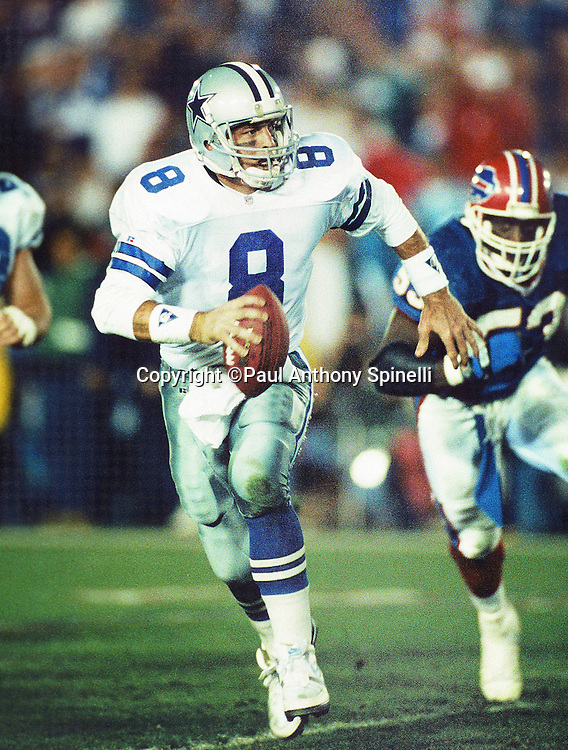 Dallas Cowboys quarterback Troy Aikman (8) scrambles while pressured by a Buffalo Bills defender during the NFL Super Bowl XXVII football game against the Buffalo Bills on Jan. 31, 1993 in Pasadena, Calif. The Cowboys won the game 52-17. (©Paul Anthony Spinelli)