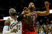 Apr 27, 2010; Cleveland, OH, USA; Cleveland Cavaliers forward LeBron James (23) battles for a rebound with Chicago Bulls forward Taj Gibson (22) during the fourth period in game five in the first round of the 2010 NBA playoffs at Quicken Loans Arena.  Mandatory Credit: Jason Miller-US PRESSWIRE