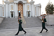 "Sentries keep vigil outside the tomb of former President Saparmurat Niyazov (""The Turkmenbashi"" -- leader of all Turkmen -- often discussed using the medieval epithet, ""the Great""). Niyazov, who died suddenly in 2006 after ruling Turkmenistan since independence, still haunts the country with golden statues and eponymous everything, but his personality cult is being dismantled in favor of his dentist and successor, Gurbanguly Berdymukhamedov.  ..The tomb is on the site of Niyazov's home village outside Ashgabat, where an earthquake in 1948 killed his mother and siblings. They are now buried -- under a colossal amount of marble -- beside him."