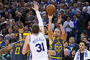 January 31, 2019; Oakland, CA, USA; Golden State Warriors guard Stephen Curry (30) shoots the basketball against Philadelphia 76ers forward Mike Muscala (31) during the fourth quarter at Oracle Arena.