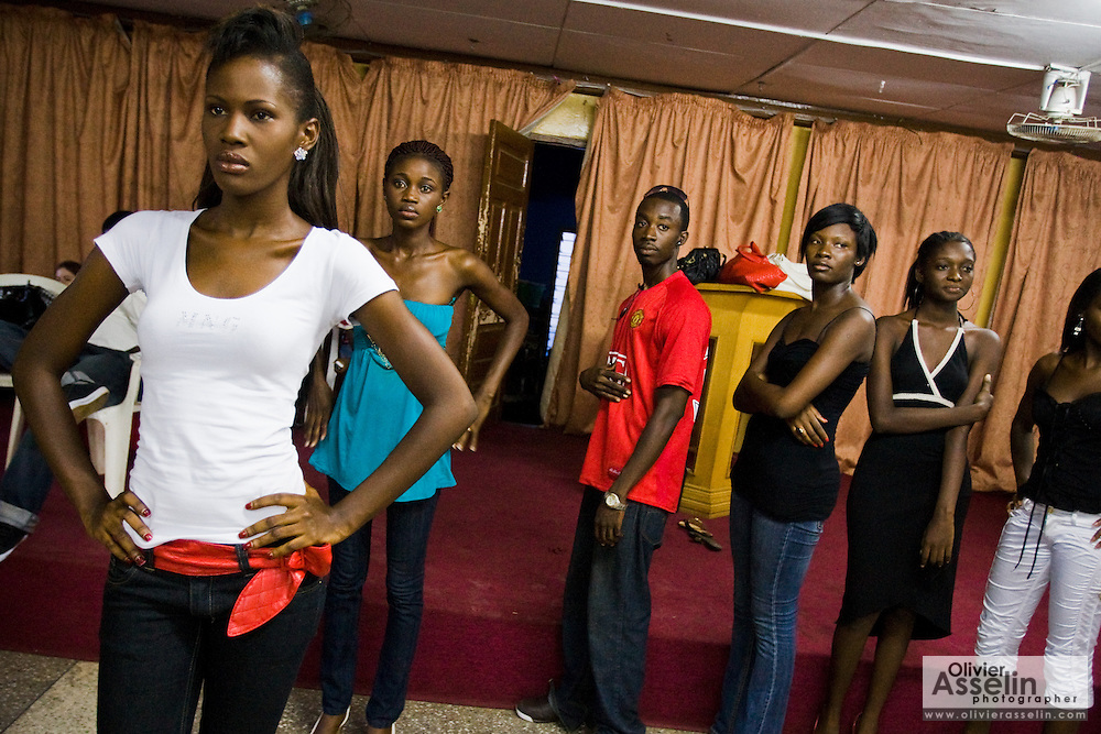 Nana Yaa Adadewa Addo (left), 24, prepares to practice her catwalk while other models wait for their turn during a rehearsal in Ghana's capital Accra on Thursday May 21, 2009. Nana Yaa is one of several Ghanaian girls who auditioned for the upcoming television show West Africa's Next Top Model, the latest incarnation of Tyra Banks' America's Next Top Model.