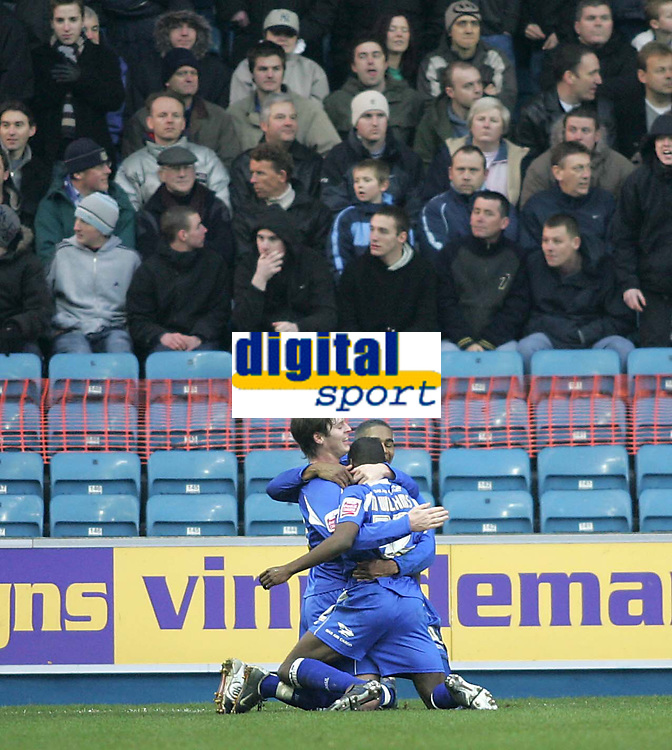 Photo: Lee Earle.<br /> Millwall v Everton. The FA Cup. 07/01/2006. Millwall players congratulate Marvin Williams after he scored the opening goal.
