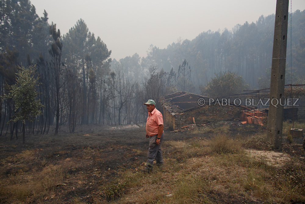 LEIRIA, PORTUGAL - JUNE 19:  Men check a burned house after a wildfire took dozens of lives on June 19, 2017 near Castanheira de Pera, in Leiria district, Portugal. On Saturday night, a forest fire became uncontrollable in the Leiria district, killing at least 62 people and leaving many injured. Some of the victims died inside their cars as they tried to flee the area.  (Photo by Pablo Blazquez Dominguez/Getty Images)