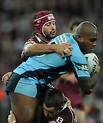 May 25th 2011: Akuila Uate of the Blues is tackled by Johnathan Thurston and Ashley Harrison of the Maroons during game 1 of the 2011 State of Origin series at Suncorp Stadium in Brisbane, Australia on May 25, 2011. Photo by Matt Roberts/mattrIMAGES.com.au / QRL