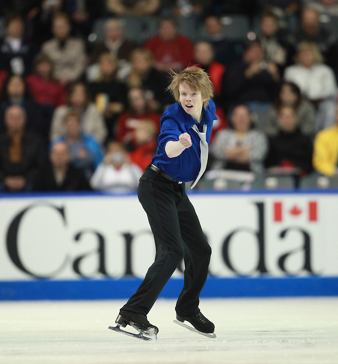 20101029 -- Kingston, Ontario --  Kevin Reynolds of Canada skates his short program at the 2010 Skate Canada International in Kingston, Ontario, Canada, October 29, 2010.<br /> AFP PHOTO/Geoff Robins