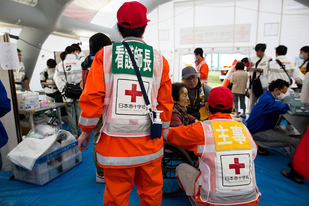 KUMAMOTO, JAPAN - APRIL 21:  Japanese red cross check ill evacuees and give medicine in the morning of April 21, 2016 in Mashiki Gymnasium evacuation center, Kumamoto, Japan. To date 45 people are confirmed dead and around 11,000 people have evacuated after an 6.5 earthquake on Thursday night and a stronger 7.3 quake on Saturday morning struck the Kyushu Island in western Japan.<br /> <br /> Photo: Richard Atrero de Guzman