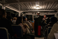 LYON, FRANCE - DECEMBER 07: People attend mass on a boat with Cardinal Barbarin during The Festival Of Lights on December 7, 2013 in Lyon, France.<br />
